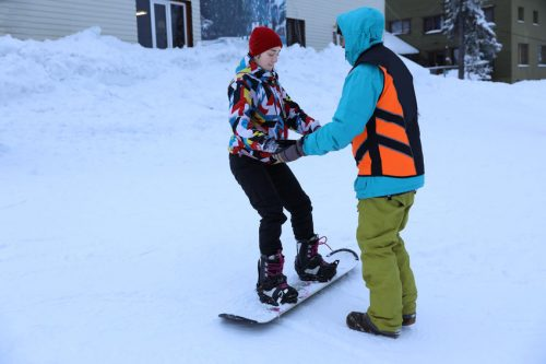 snowboard instructor teaching at a ski resort