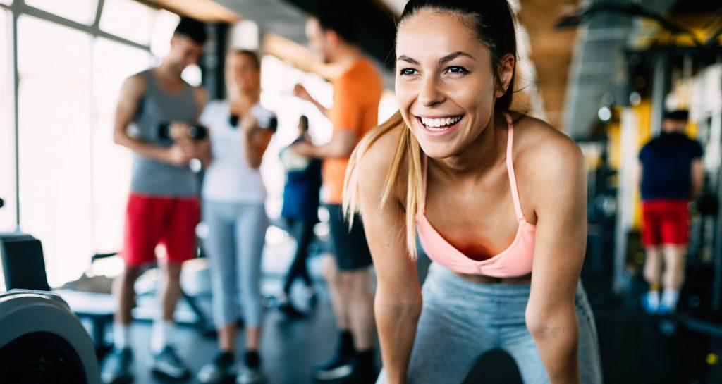 employee happily exercising and feeling strong